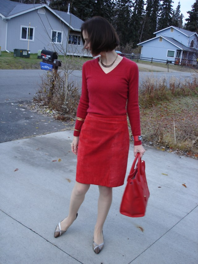 mature woman in monochromatic look with suede and knit