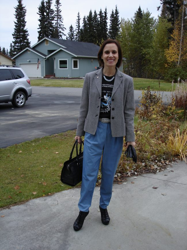 style book author in black white blue look with college Tee, leather carot pants, fall sandals, houndstooth blazer