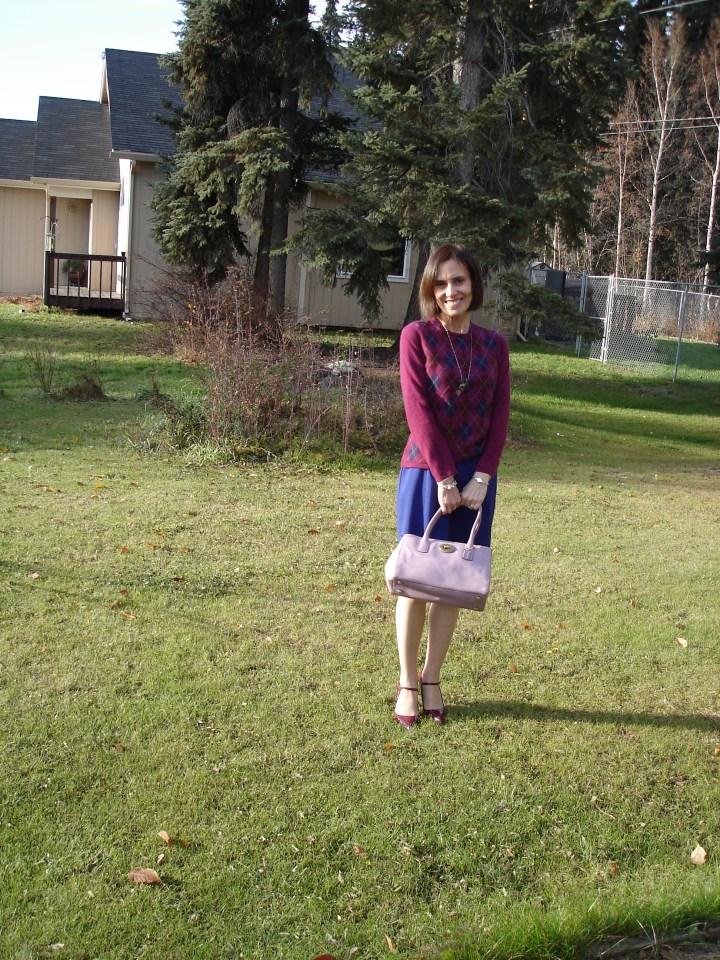 #fashionover40 mature woman wearing a argyle sweater over a sheath dress