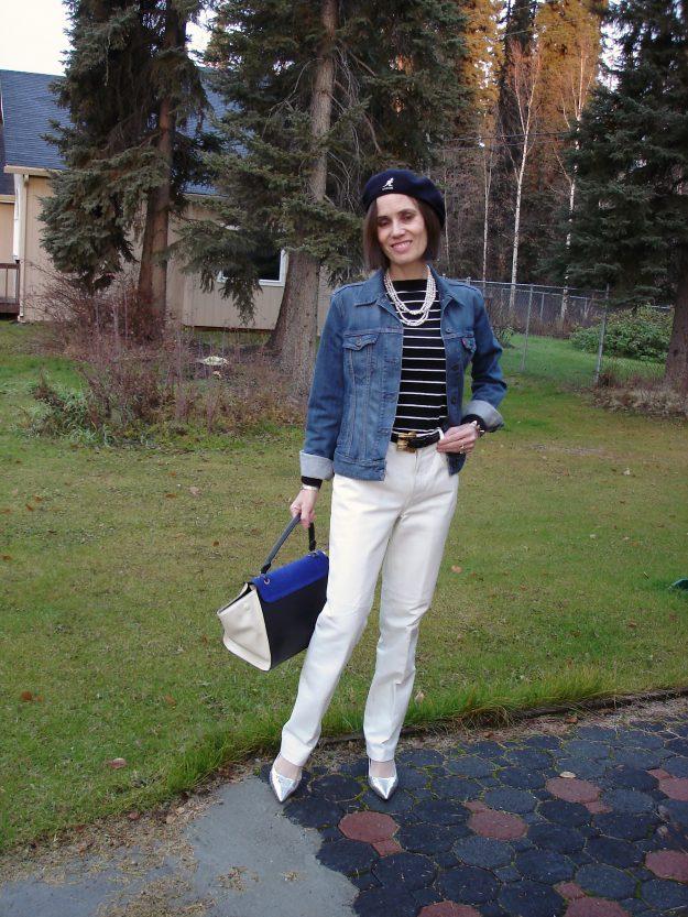 midlife influencer in maritime sweater white pants denim jacket separates