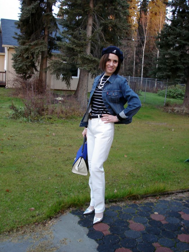 over 50 years old woman in white leather pants, nautical sweater, driver cap in fall
