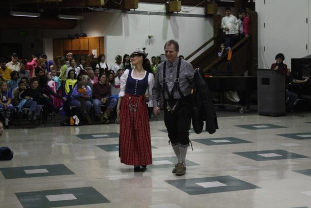 woman in dirndl and man in lederhosen