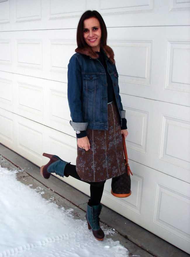 fashion blogger over 55 in tweed skirt and denim jacket