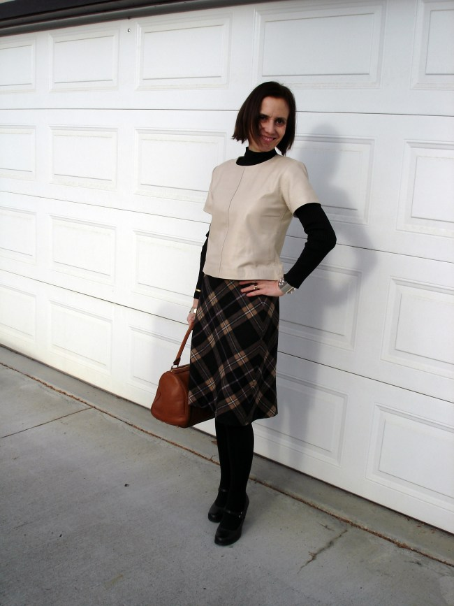 #fashionover40 mature woman in work outfit with plaid skirt