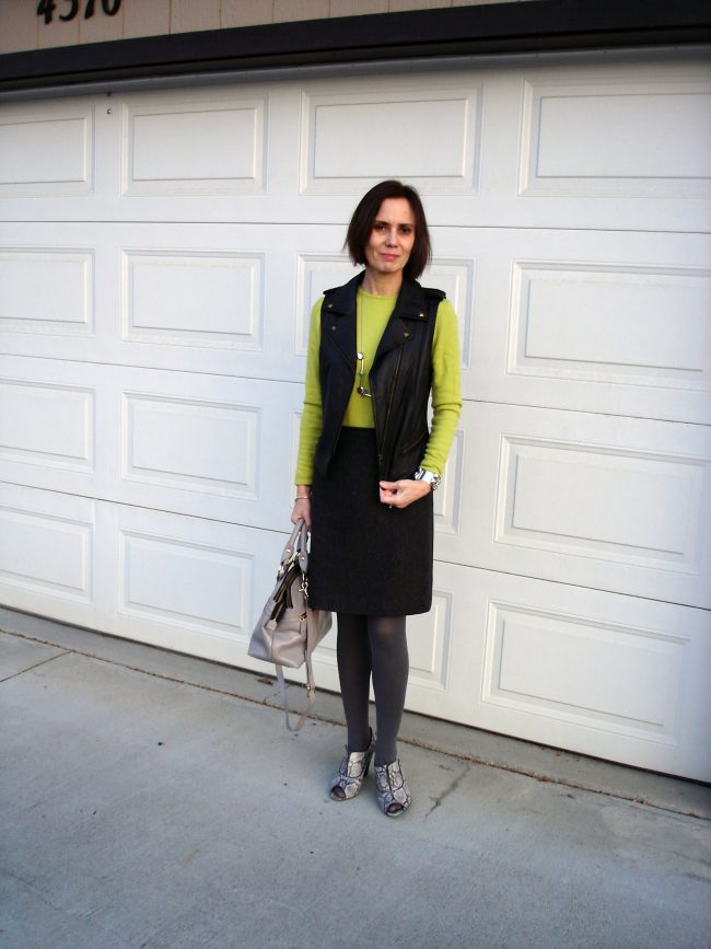 stylist in chartreuse sweater, leather vest, fall sandals, tweed skirt