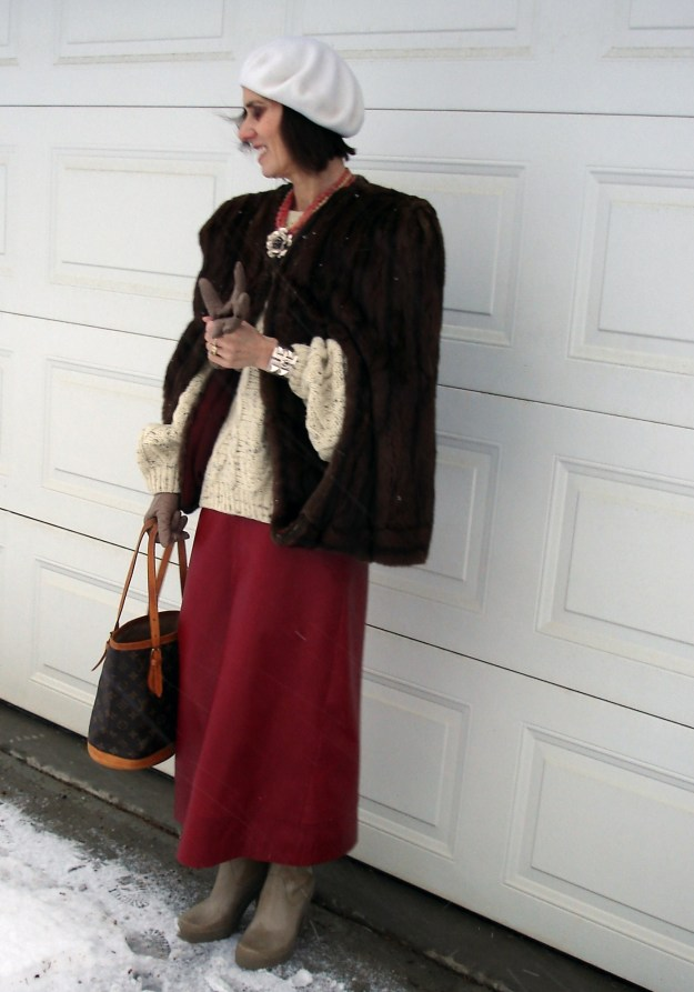 fashion over 50 Winter look with cape and long leather skirt
