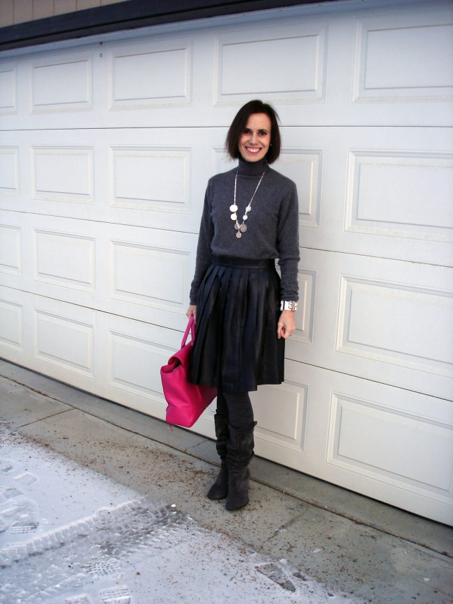 fashion influencer in pleated leather skirt gray turtleneck sweater