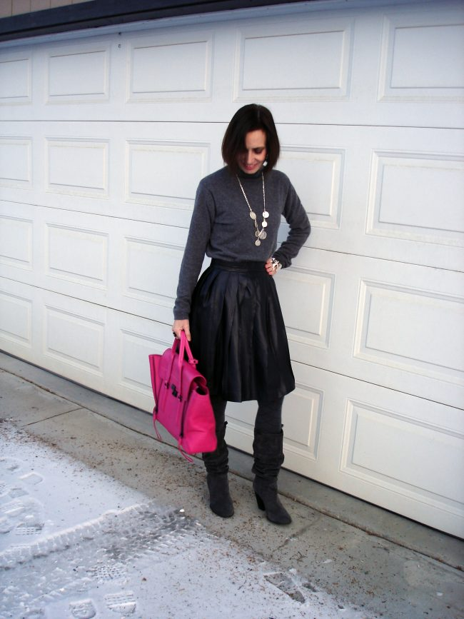 over 50 years old street style blogger in leather skirt with pleats and sweater
