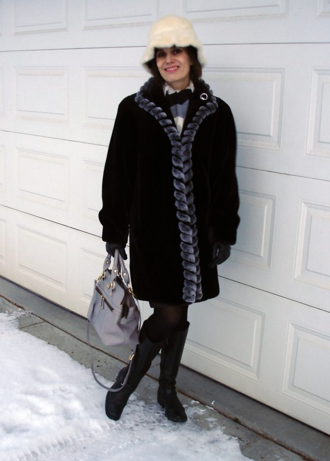 A-line faux fur frock with riding boots and bucket hat