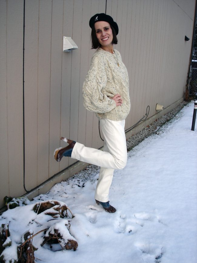 fashion blogger in white leather pants with cable knit sweater