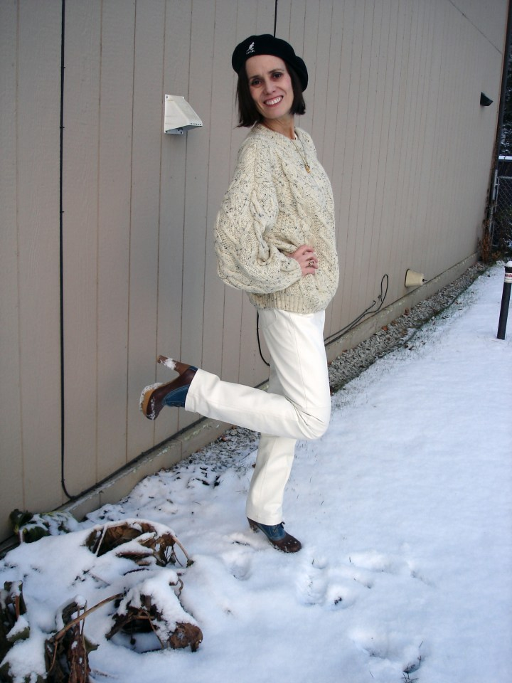 fashion over 40 woman in white leather pants with cable knit sweater