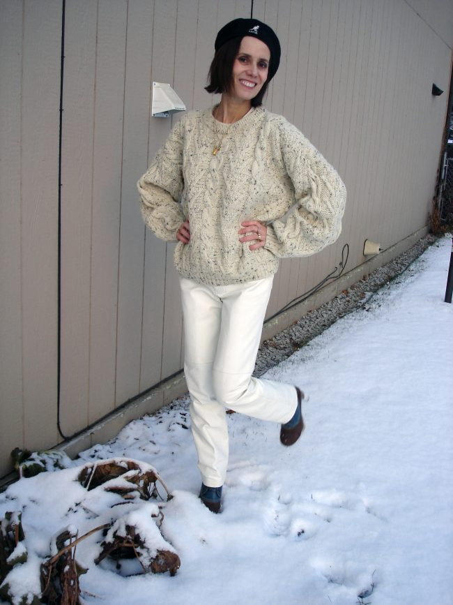 white leather pants with oversize cable knit sweater