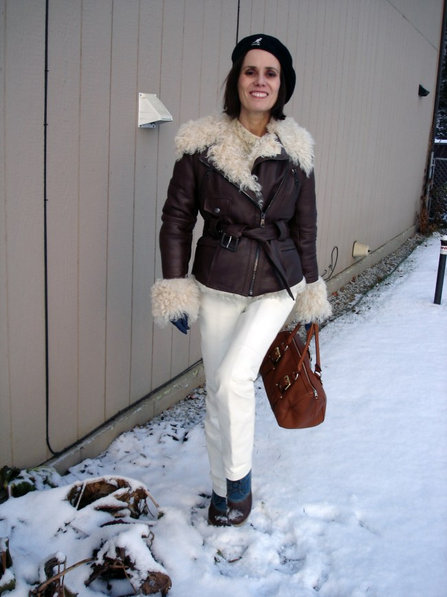 mature fashion winter outfit with white leather pants and motorcycle shearling jacket