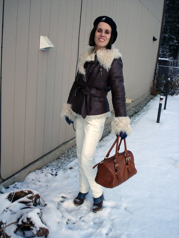 fashion over 50 woman in shearling jacket and white pants