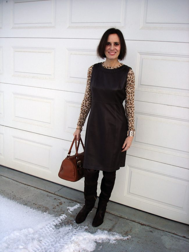 influencer in leo print with leather sheath