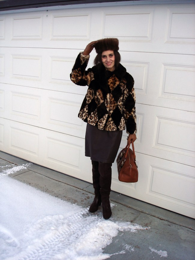 over 50 years old Alaskan blogger in classic winter outfit with pill box