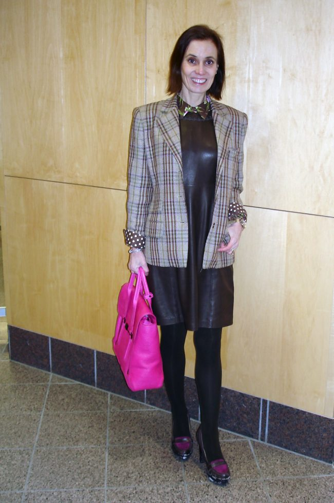 older woman in leather jumper with blazer