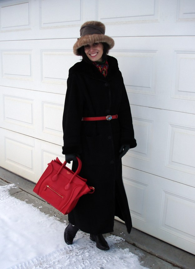 #styleover40 fashion blogger wearing a classic winter outfit with riding boots and sheath dress