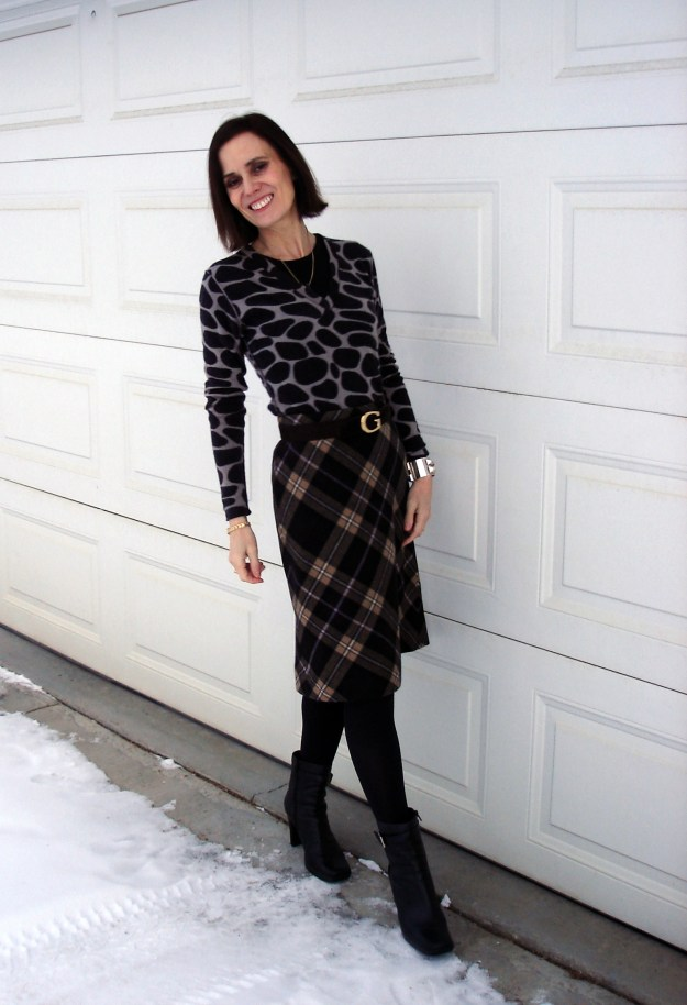 fashion over 40 woman in posh eclectic plaid skirt with animal print