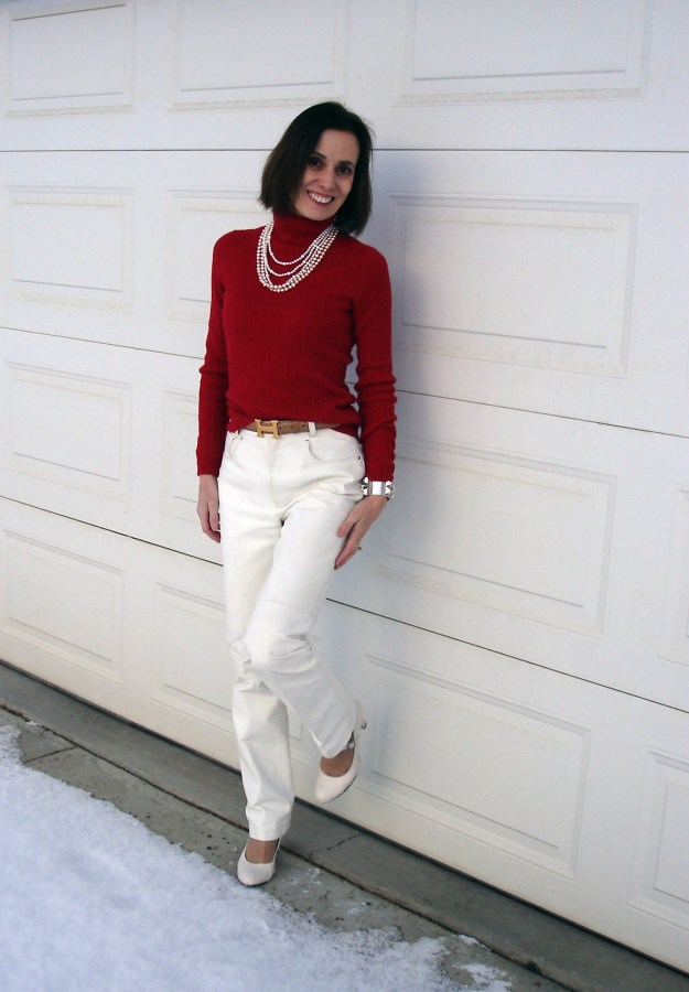 employee in winter style with white pants with red turtleneck and pearl