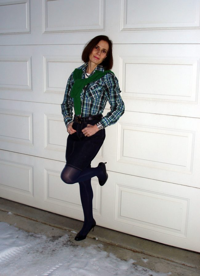 over 50 years old stylist in plaid shirt with denim skirt tights and sweater