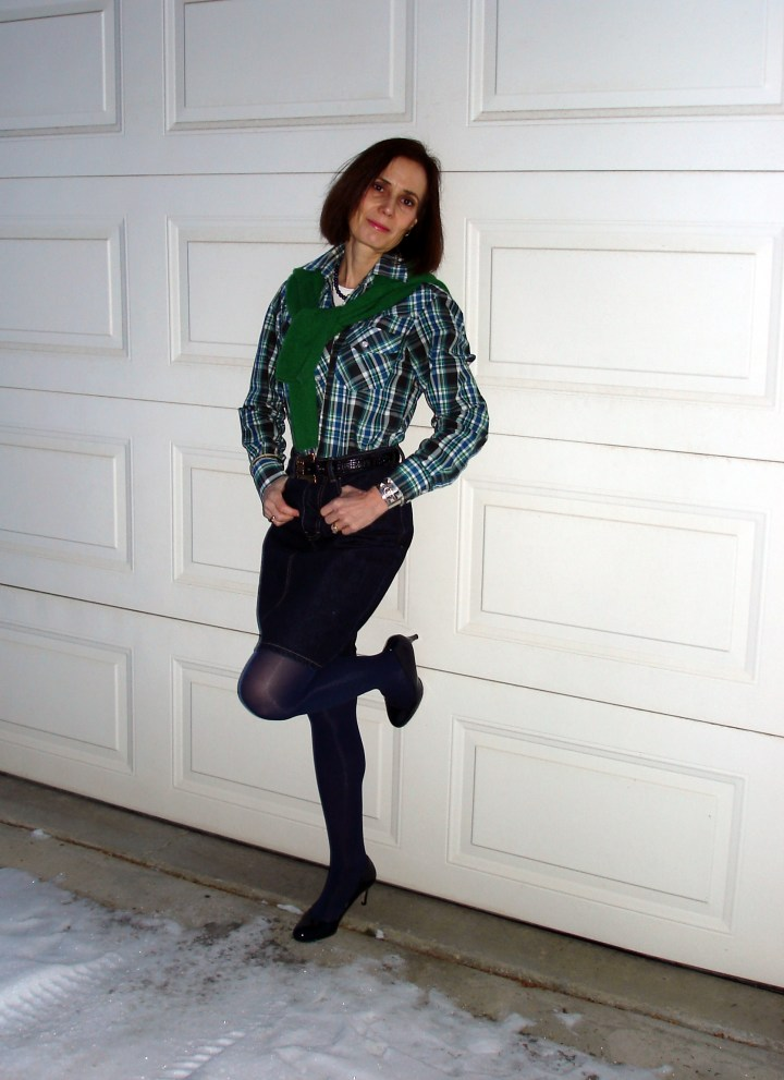 over 50 years old woman in plaid shirt with denim skirt tights and sweater