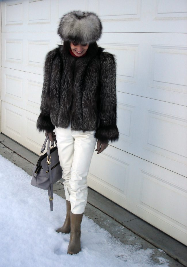 influencer in white leather pants fur jacket and hat rubber boots