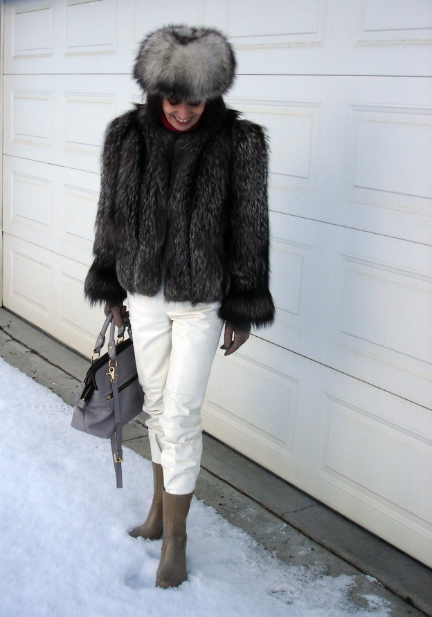 over 50 years old fashion blogger in business casual winter outerwear attire