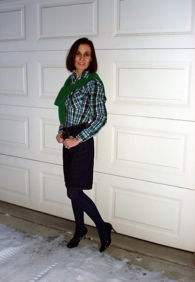 style book author in green-blueplaid shirt, matching sweater and denim skirt