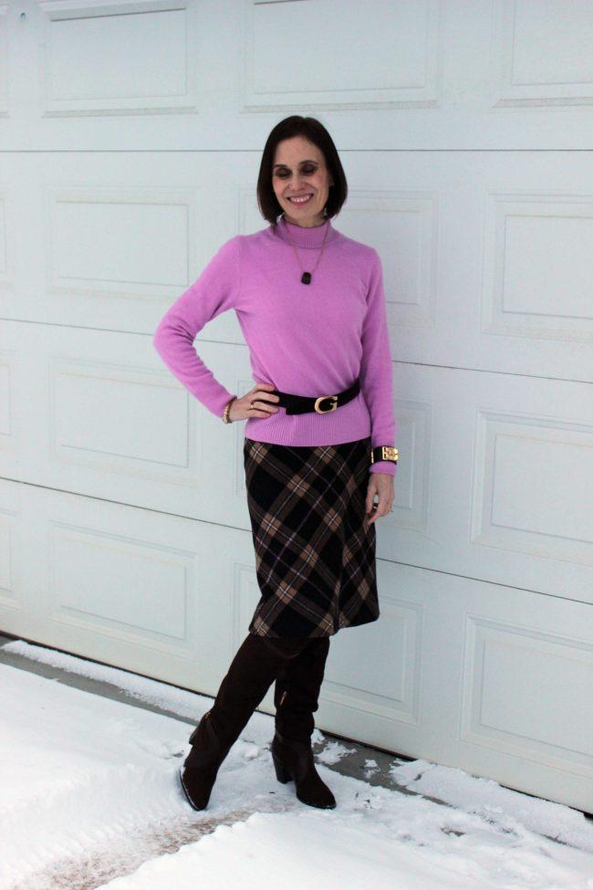 stylist in pink sweater, gucci belt, plaid brown skirt