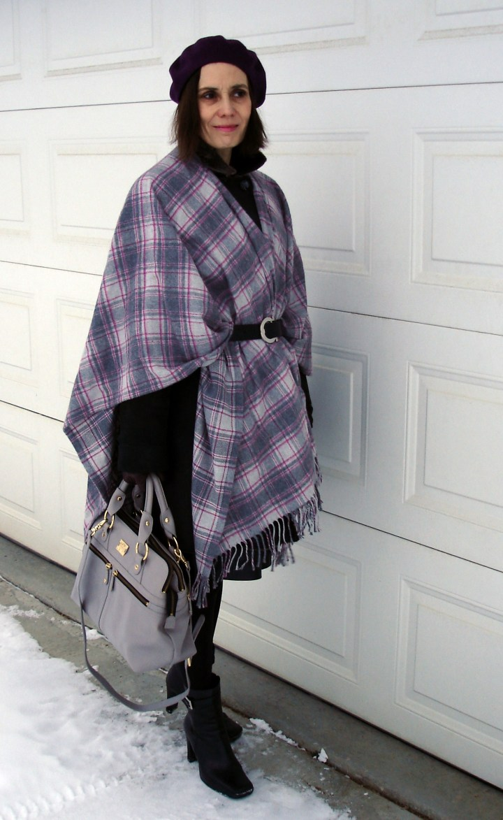 style blogger wearing fall's cape over coat fashio