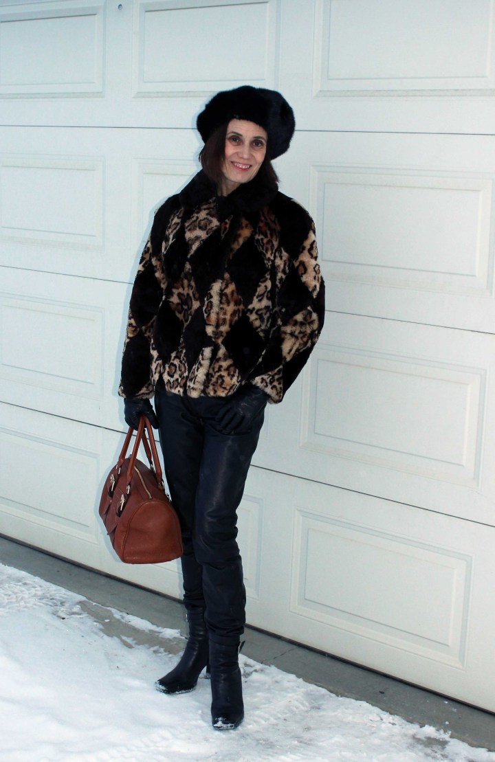 fashion blogger winter style with leather trouser and statement jacket