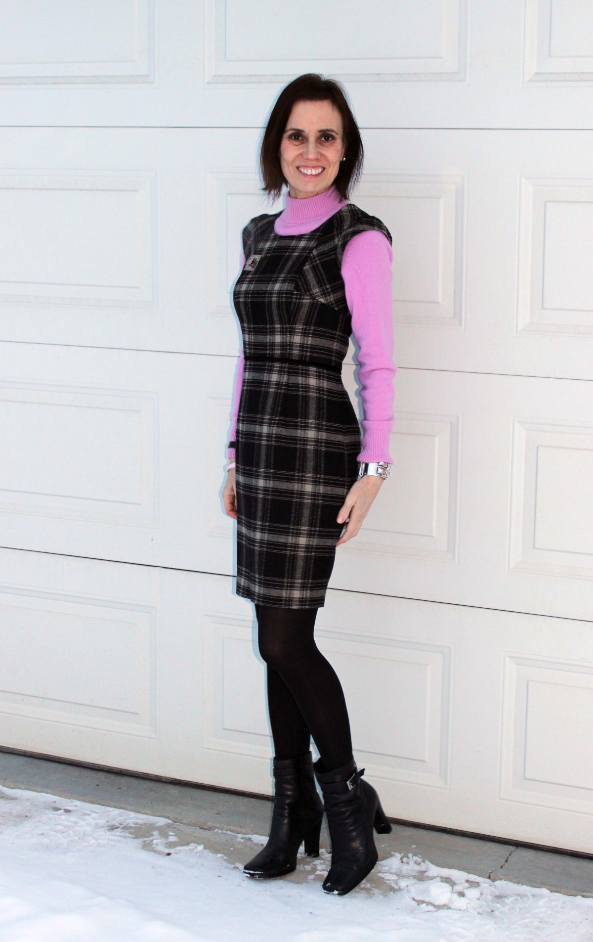 blogger in mock neck cashmere knit sweater under a sheath dress