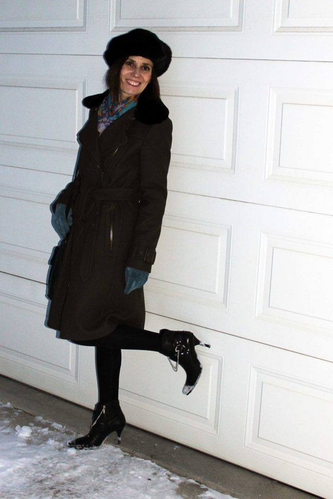 fashion blogger in motorcycle coat and booties with chains