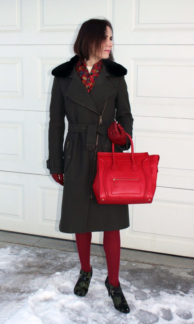 fashion over 50 blogger Nicole in army green coat, red legwear and camo booties