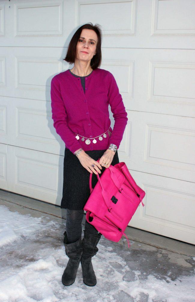 stylist in fuchsia top, gray skirt