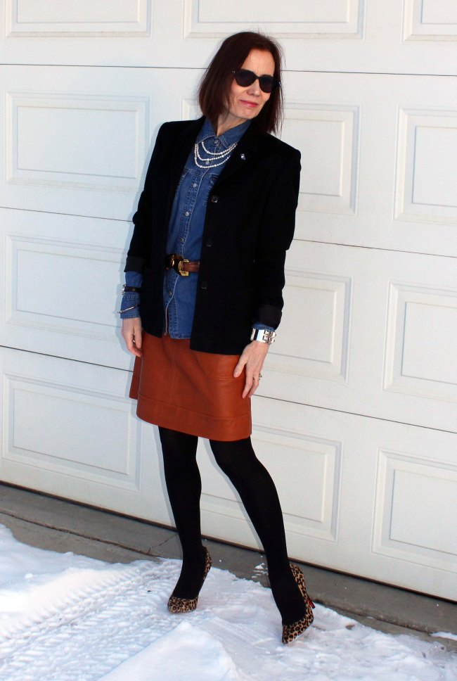 mature blogger in a winter office outfit with blazer, pumps, and skirt