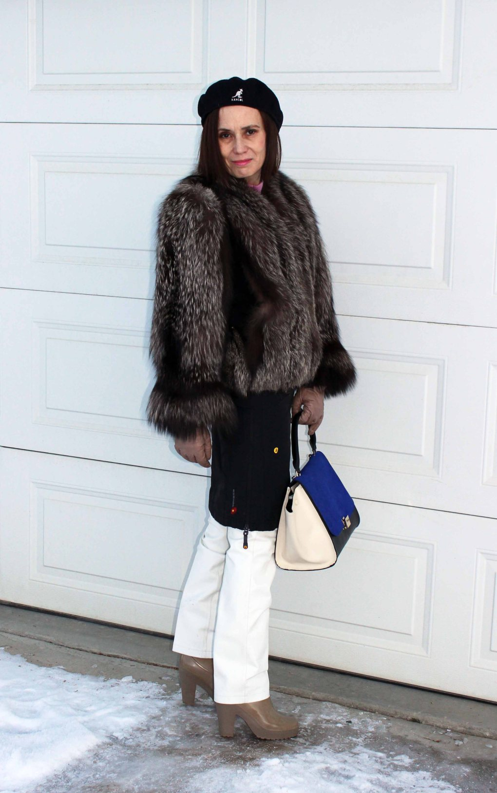 #fashionover50 woman in white pants and black skirt