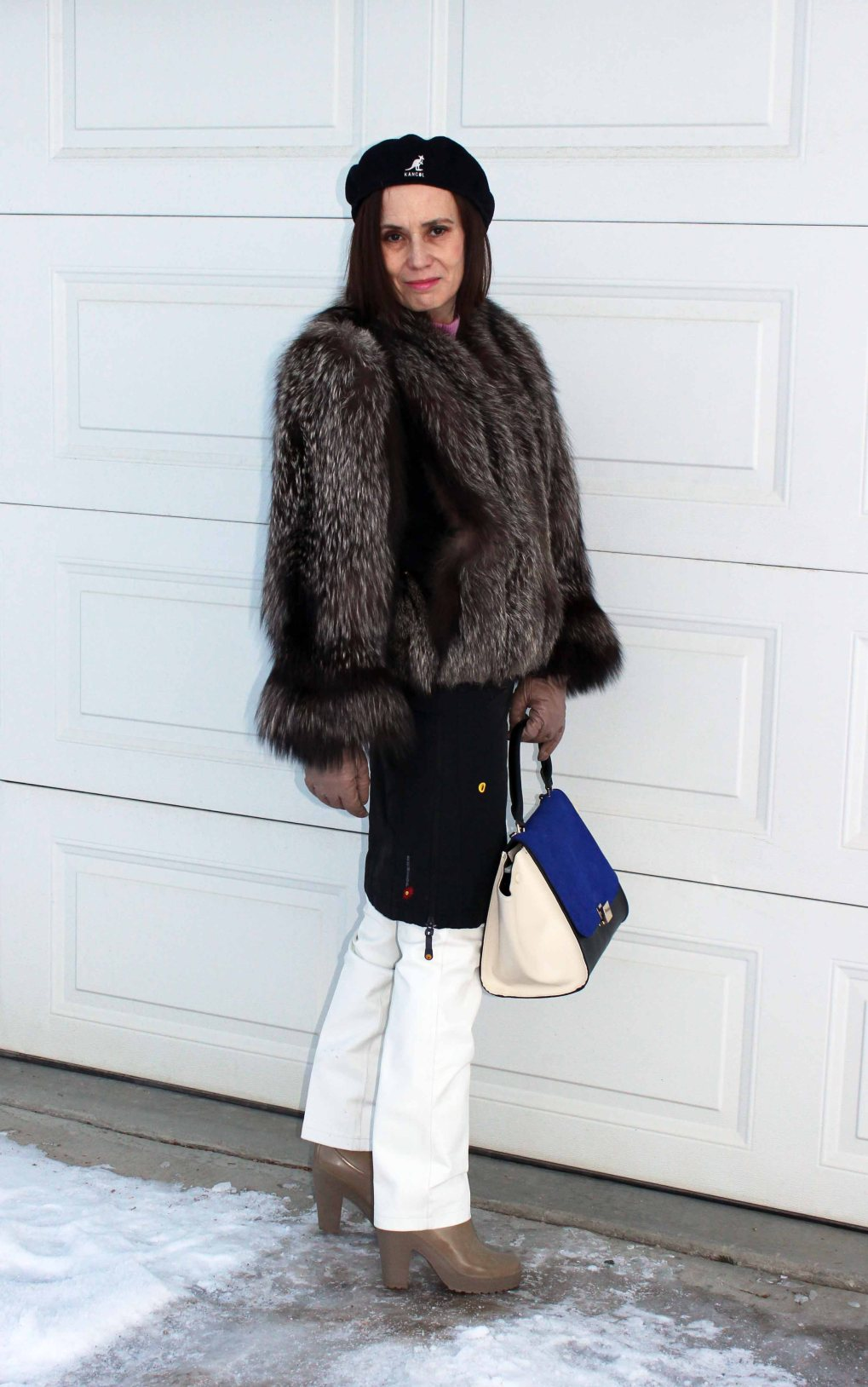 #fashionover50 mature woman wearing winter wind protecting outerwear