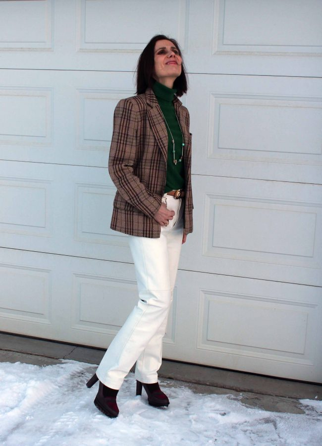 style book author in Burberry blazer winterwhite pants, green sweater