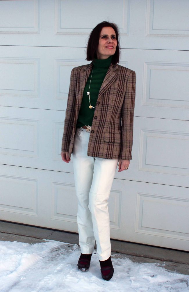 stylist in plaid blazer, green turtleneck leather pants