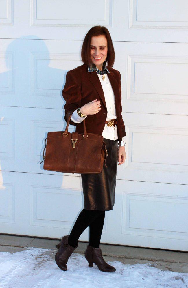 fashion blogger over 50 in black leather skirt brown blazer