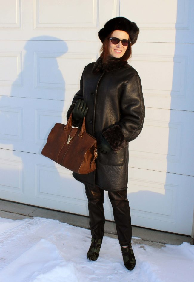 stylist in shearling, high heel booties fur hat