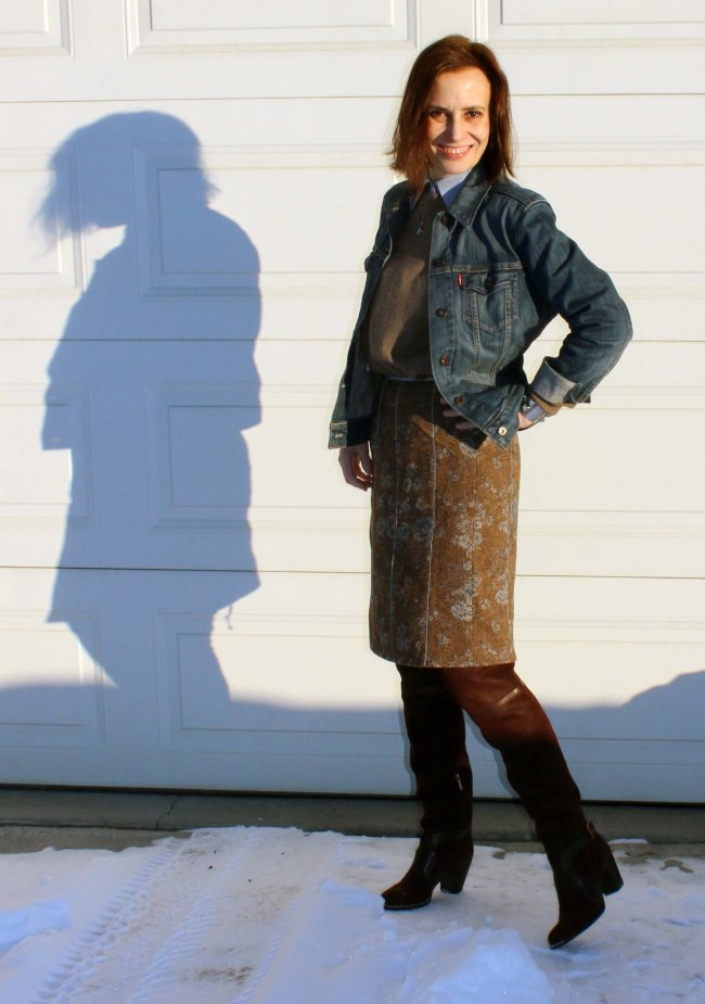 #fashionover50 50+ woman with knee-length tweed skirt, denim jacket sweater, shirt and OTK boots over-the-knee boots
