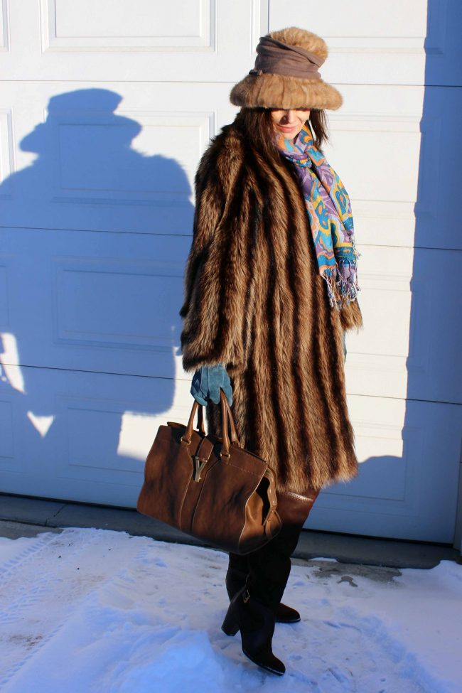 mature woman looking posh chic in winter outfit with over-the-knee boots