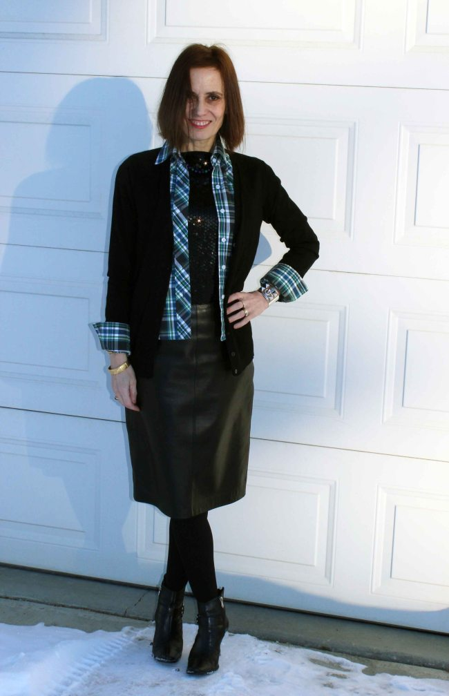 #maturestyle woman standing in the shade with a casual work outfit with plaid and sequins