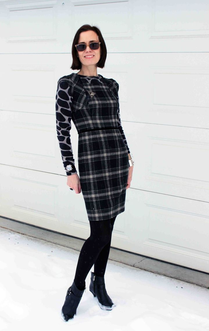 #styleover50 woman in plaid sheath with girafe print sweater