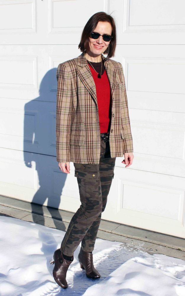 fashion blogger over 40 in street style camouflage and red outfit with tartan blazer