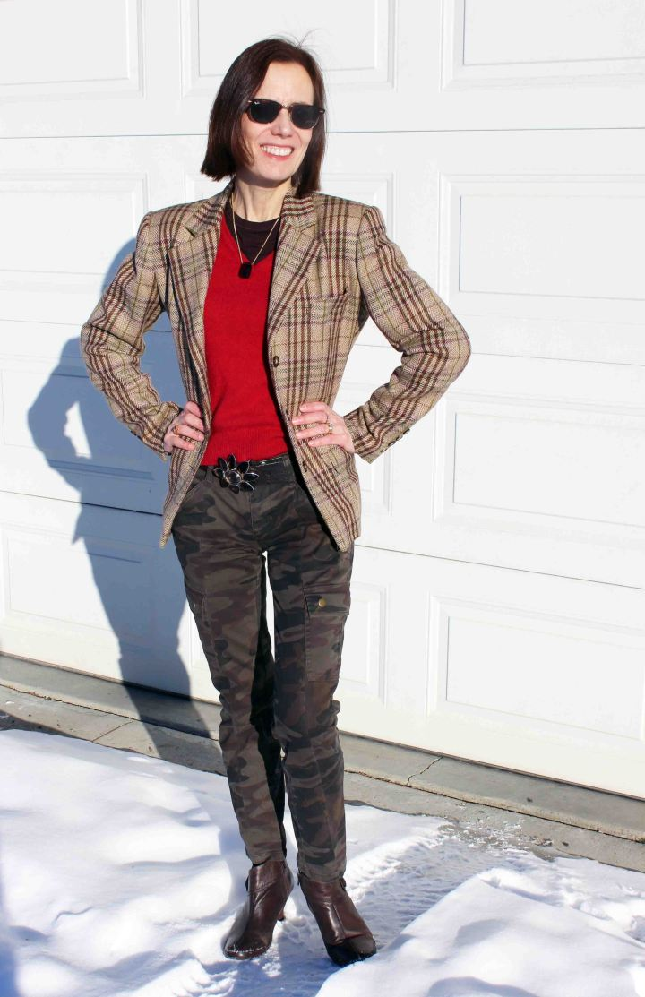 style blogger over 50 in street chic in mixed print trend pattern with plaid and camo