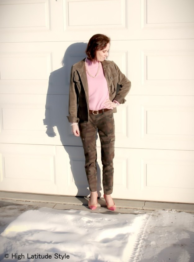 #fashionover50 woman in looking great in camouflage cargo pants and pink sweater
